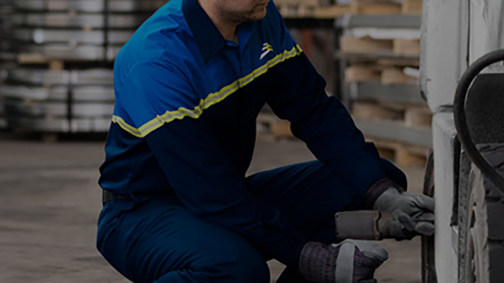 Worker performing Camso's Solideal on-site service