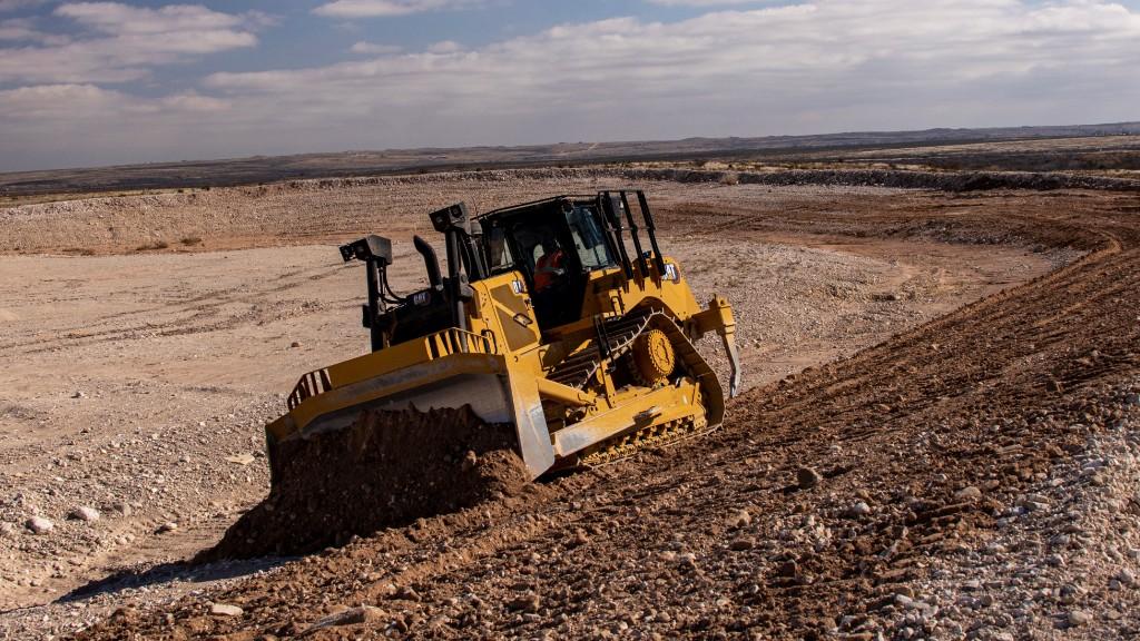 Cat D7 dozer pushing dirt on a slope