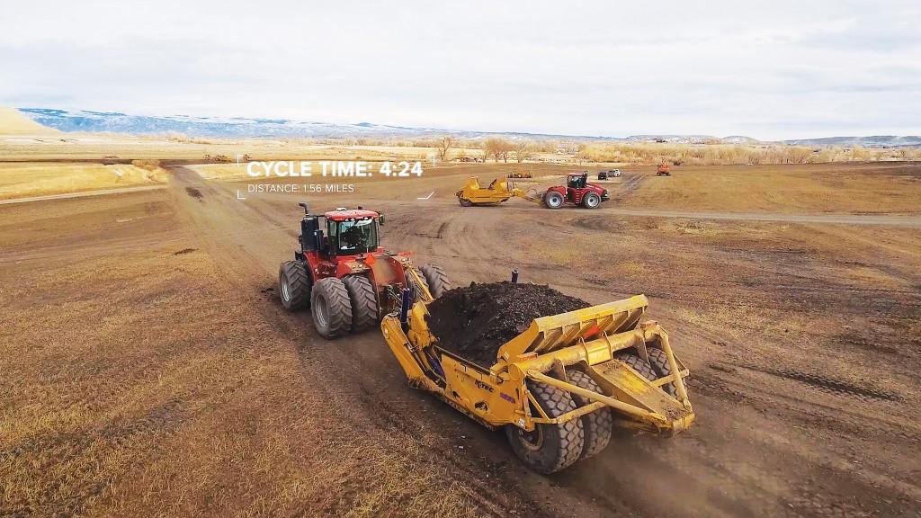 A tractor pulls a K-Tec scraper