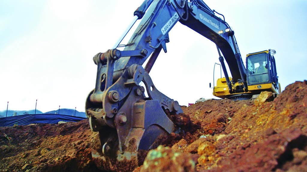 worker operates a machine in a worksite