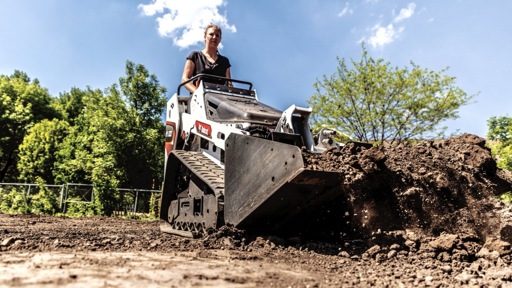 Bobcat mini track loader moves dirt