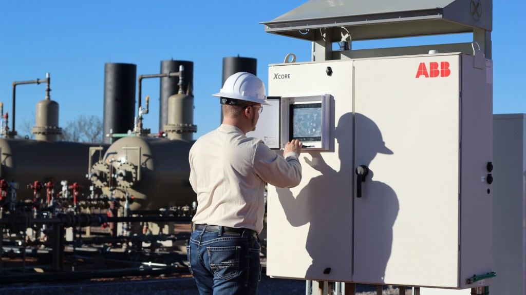 worker inputs information on a ABB controller