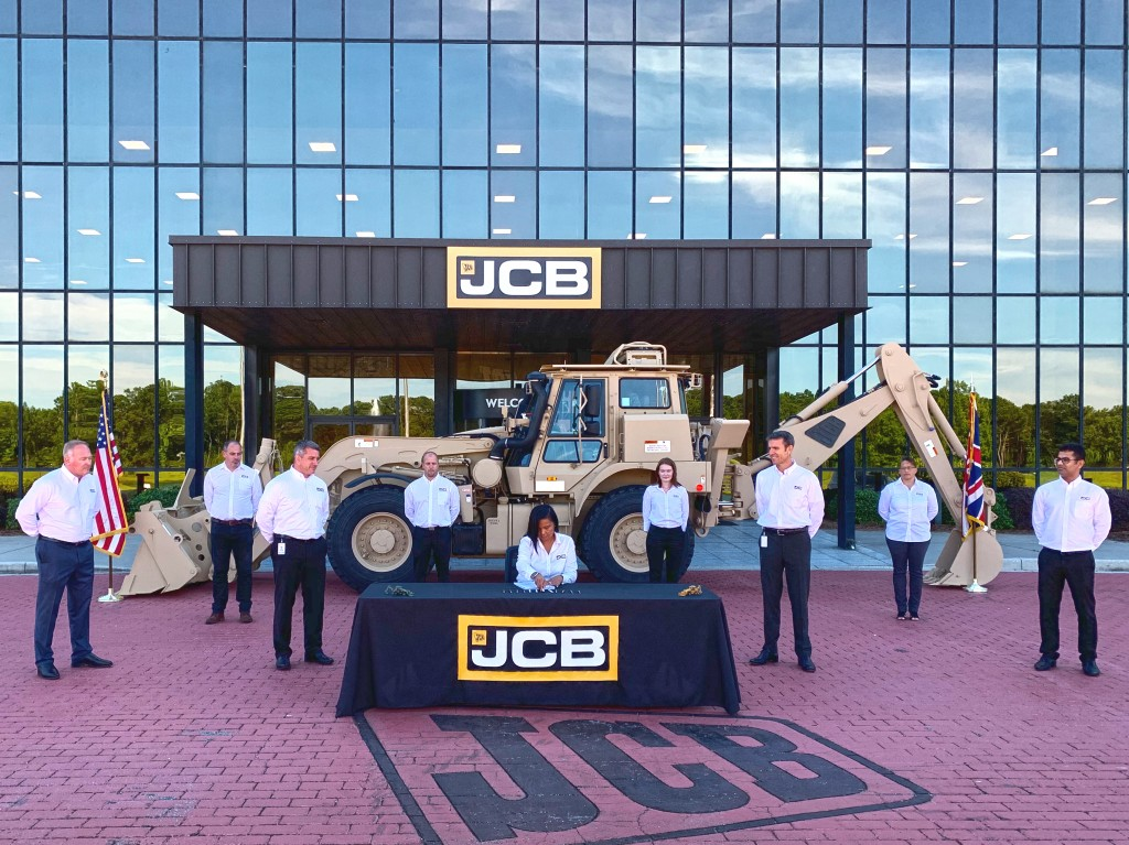 JCB signing of military agreement with JCB team and HMEE in background