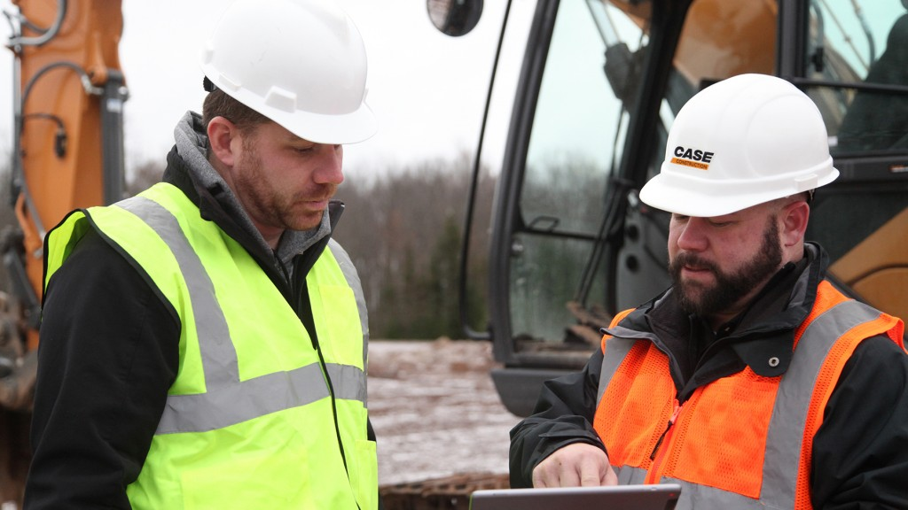 two Case workers discuss information on sitewatch tablet app