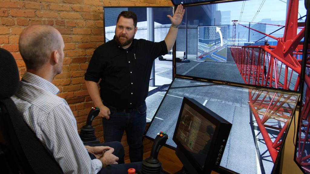 two men discuss a CM Labs crane simulator