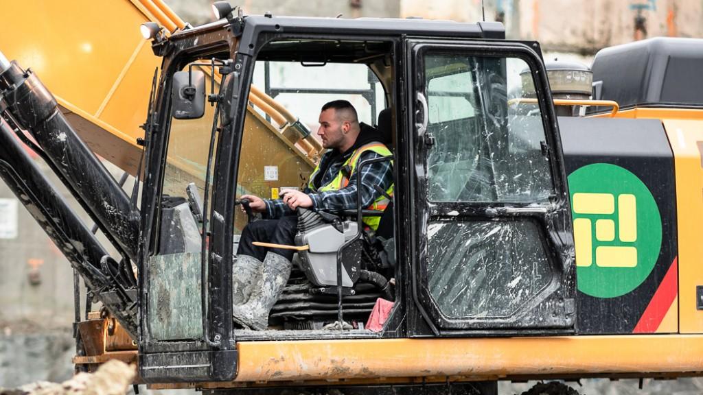 man operates a excavation machine