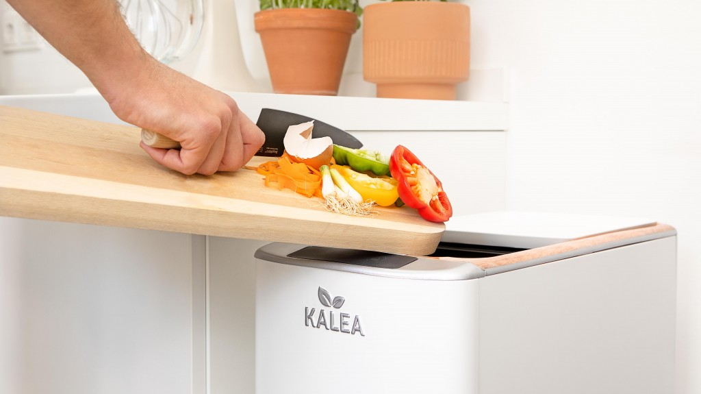 Indoor electric kitchen composter turns organic waste into compost in 48 hours