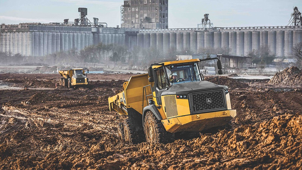 John Deere ADT drives through muddy terrain