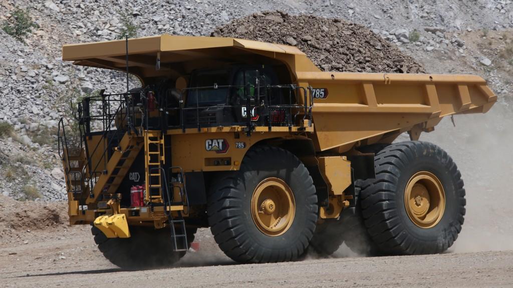 cat next gen 785 mining truck hauling in a mining worksite