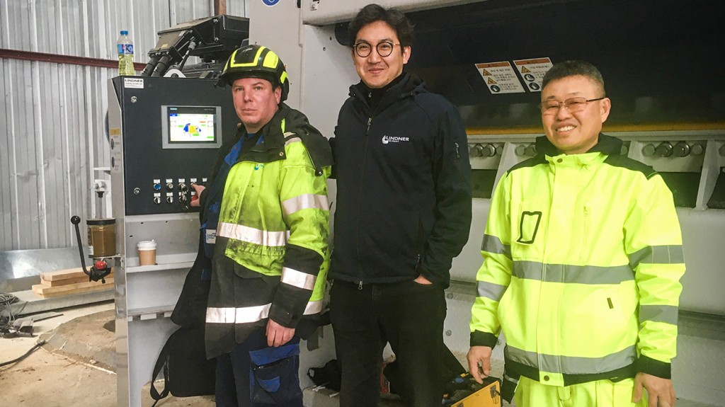 three Lindner Recycling workers pose at Singapore plant