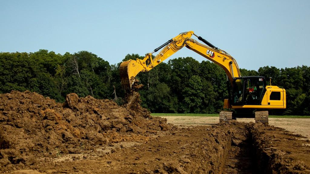 cat 317 excavator in action