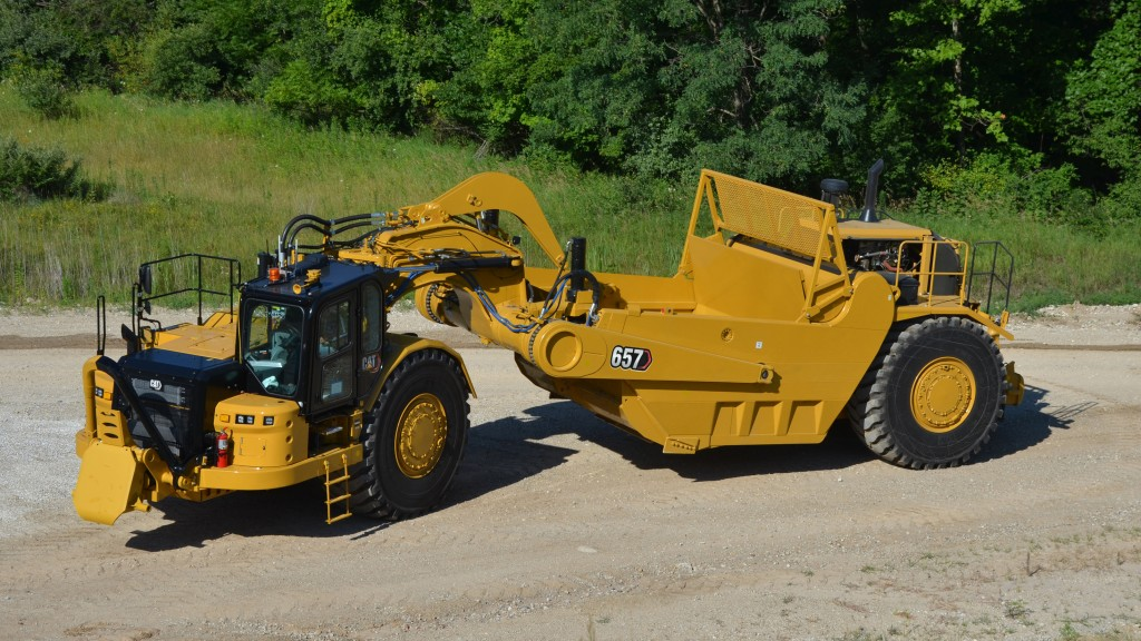 new Cat® 657 Wheel Tractor-Scraper on a road