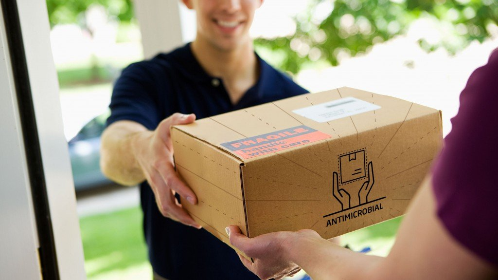 antimicrobial packaging being delivered to a house