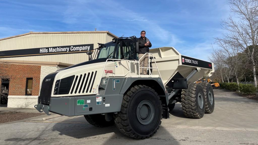 man standing on a TA300 articulated hauler