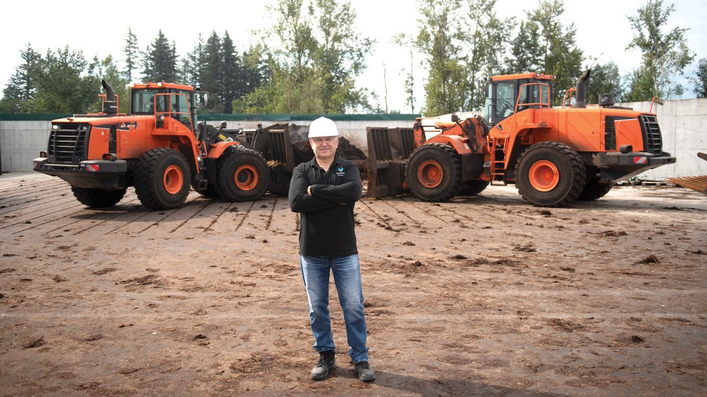 Zelko Fuduric, GM and facility director at Central Composting in Abbotsford, B.C., with Doosan DL420-3 and DL420-5 wheel loaders outfitted with forked buckets.