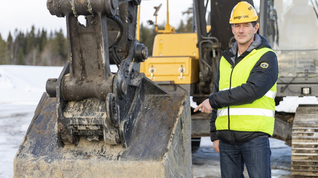 Stig Engström, owner and founder of Engcon, standing next to a machine