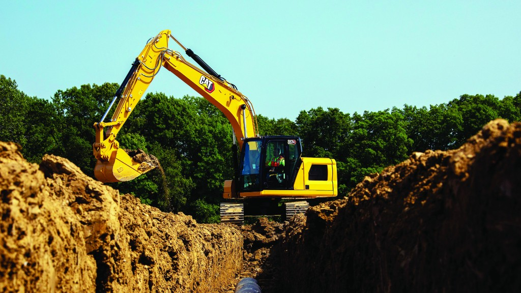 Caterpillar 317 Next Gen excavator above a trench