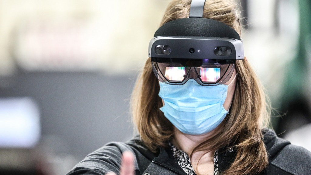 woman wearing a facemark and a HoloLens