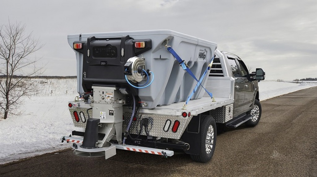 Hilltip IceStriker™ 1200-4200AM Combi Spreader in action on a road