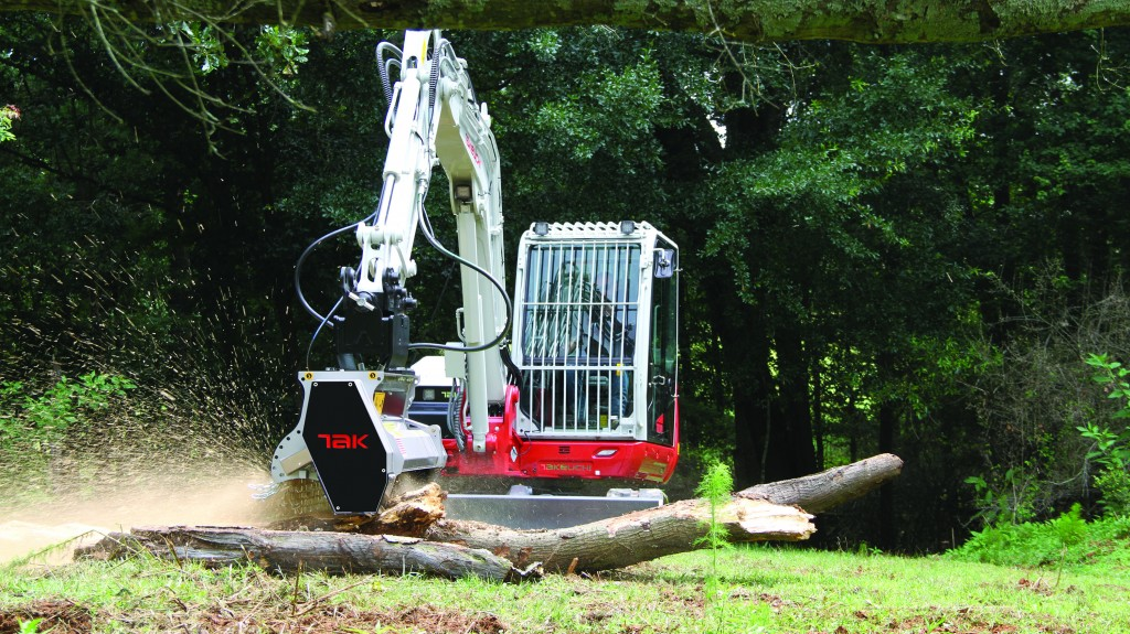 Takeuchi tb 370 mulching head on a skid steer in the forest