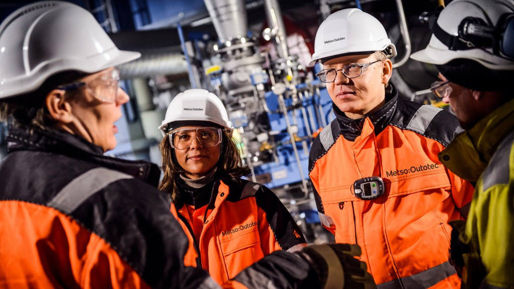 metso Outotec workers with hard hats on at a facility