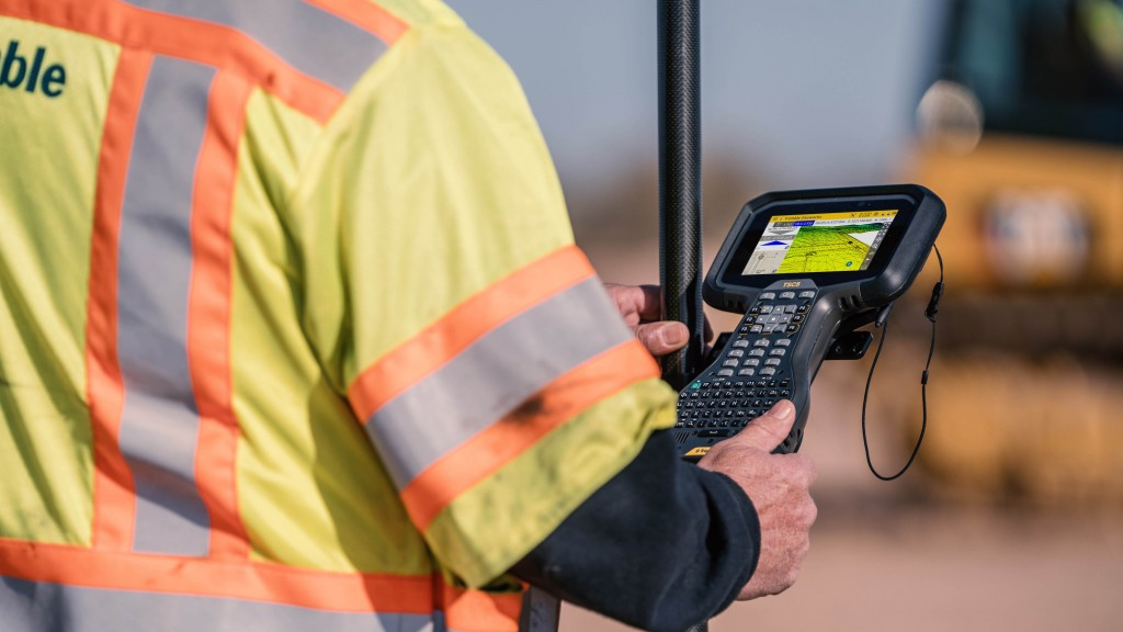 trimble siteworks software trimble tsc5 controller being used by a Trimble technician