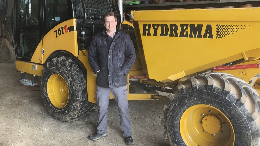 man stands in front of Hydrema machine