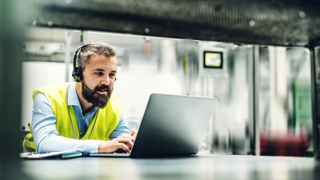 customer service agent types on computer with headset