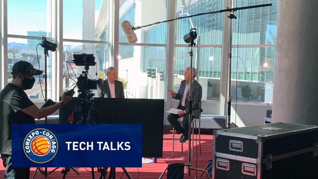 CONEXPO-CON/AGG tech talk between two men