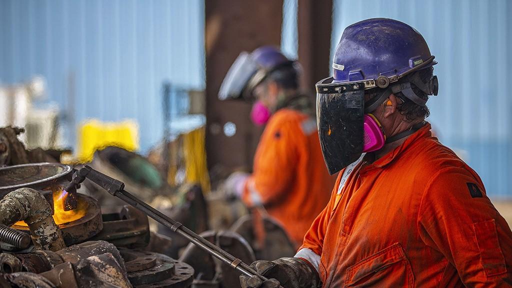 men welding in a shipyard