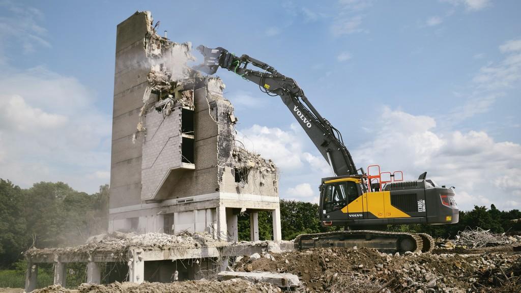 Volvo CE EC380E straight boom demolition excavator tears down building