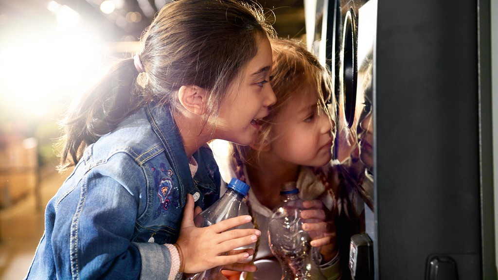 Kids looking at a reverse vending machine