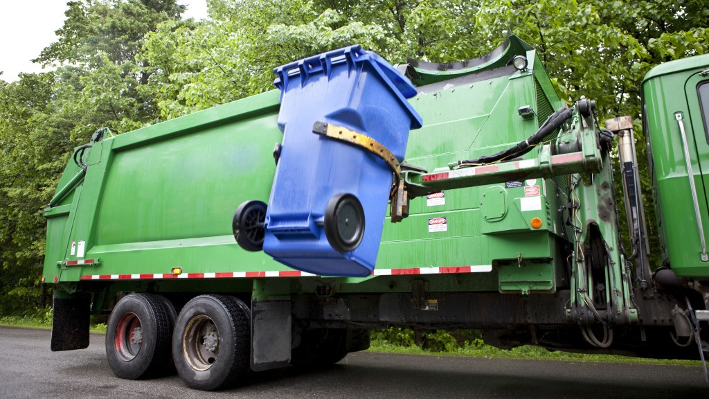 collection truck lifting a recycling bin