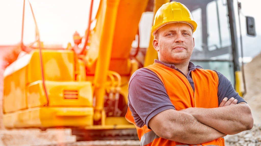 ARA contractor in front of heavy construction equipment