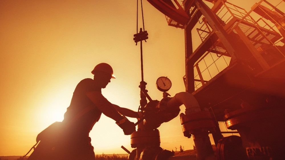 man operating a oil rig