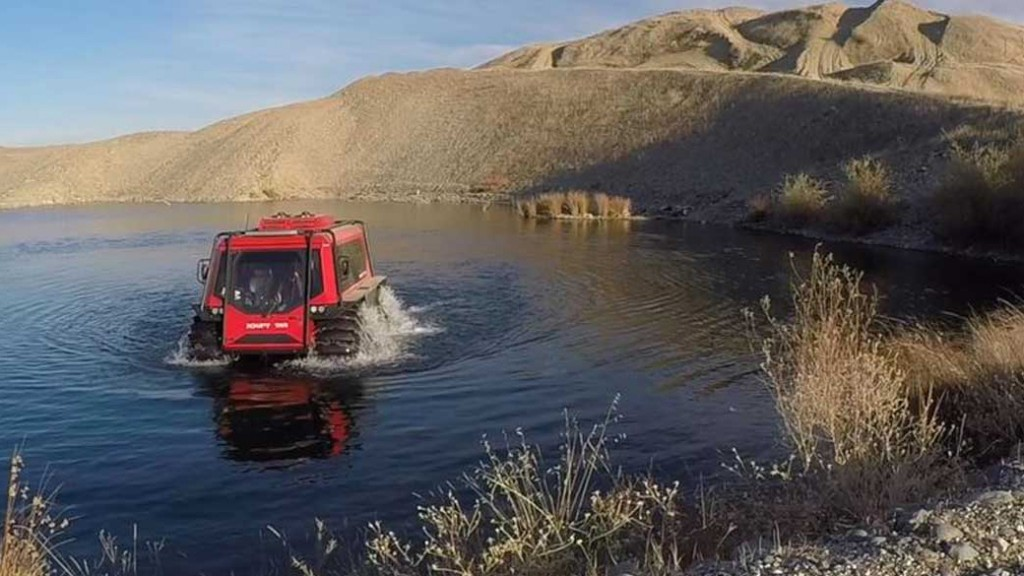 fat truck amphibious vehicle in a pond