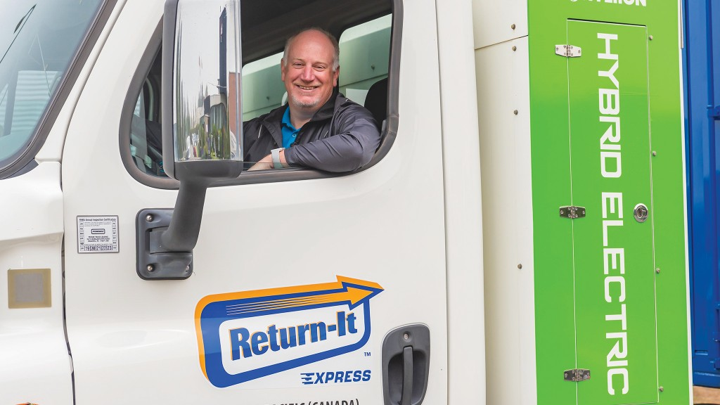 Return-It president and CEO, in a Hyliion compressed natural gas (CNG) hybrid-electric compaction truck, a first in Canada, and which has been part of a pilot in B.C. since fall 2020.