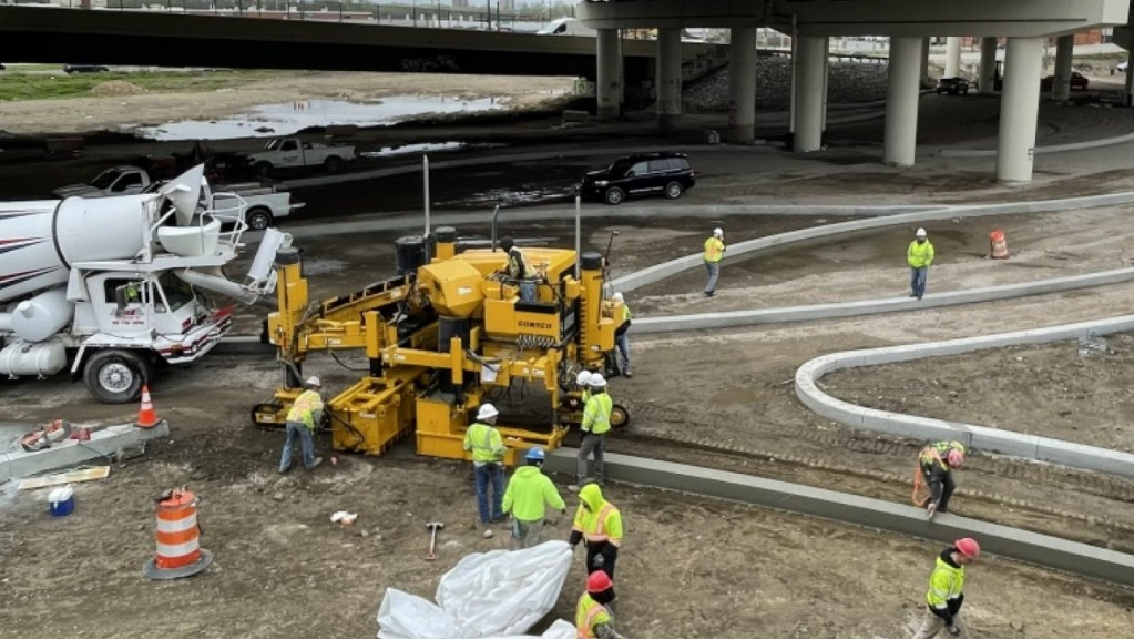 Robotics technology used to aid curb and gutter paving