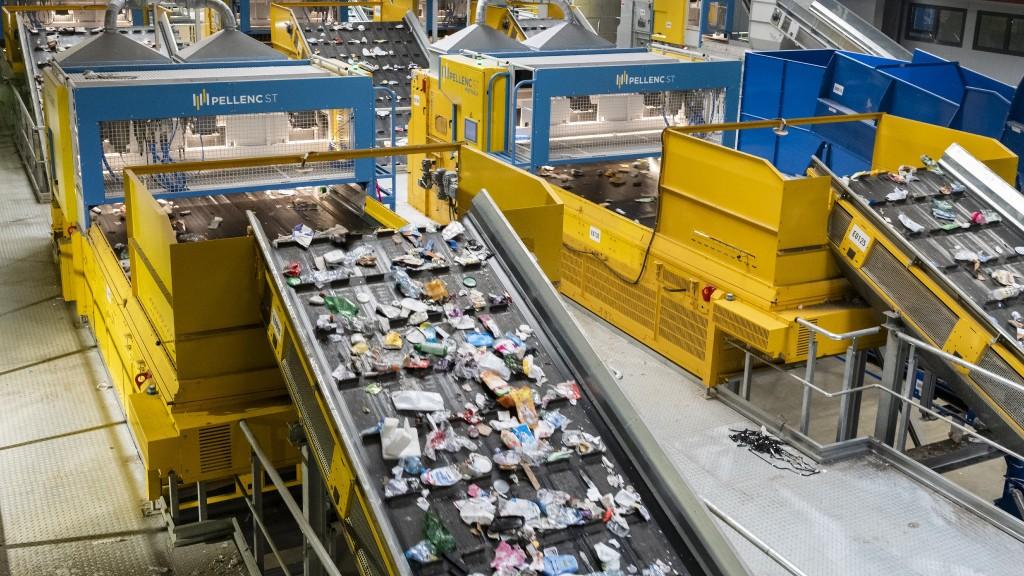 Recycling sorters sort through various plastics
