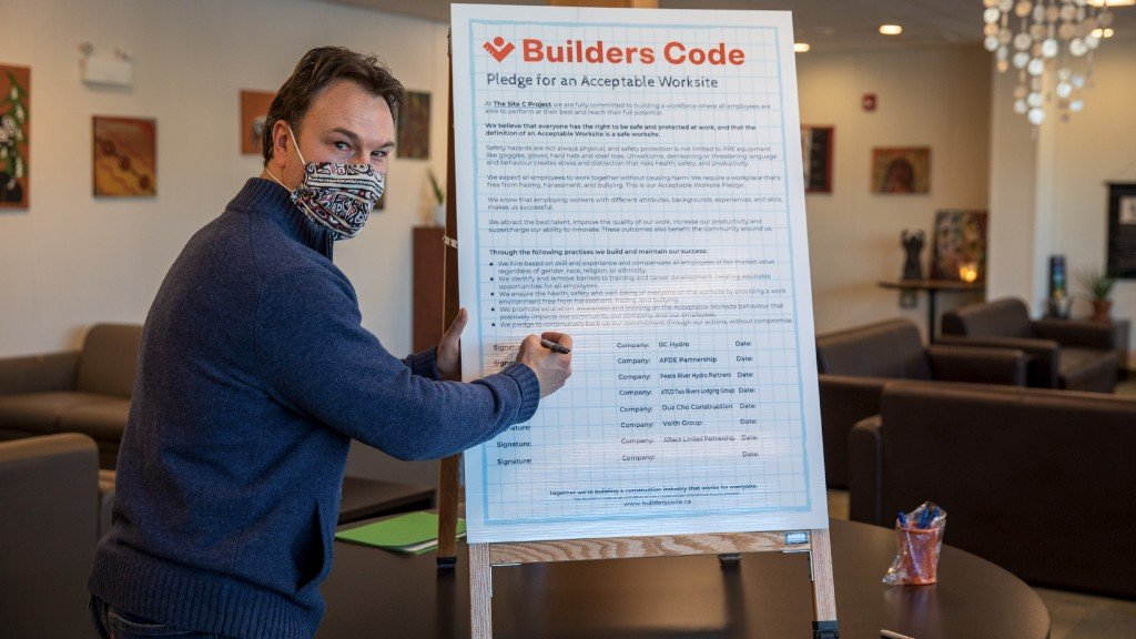 Chris Waite of BC Hydro signs the new Builders Code