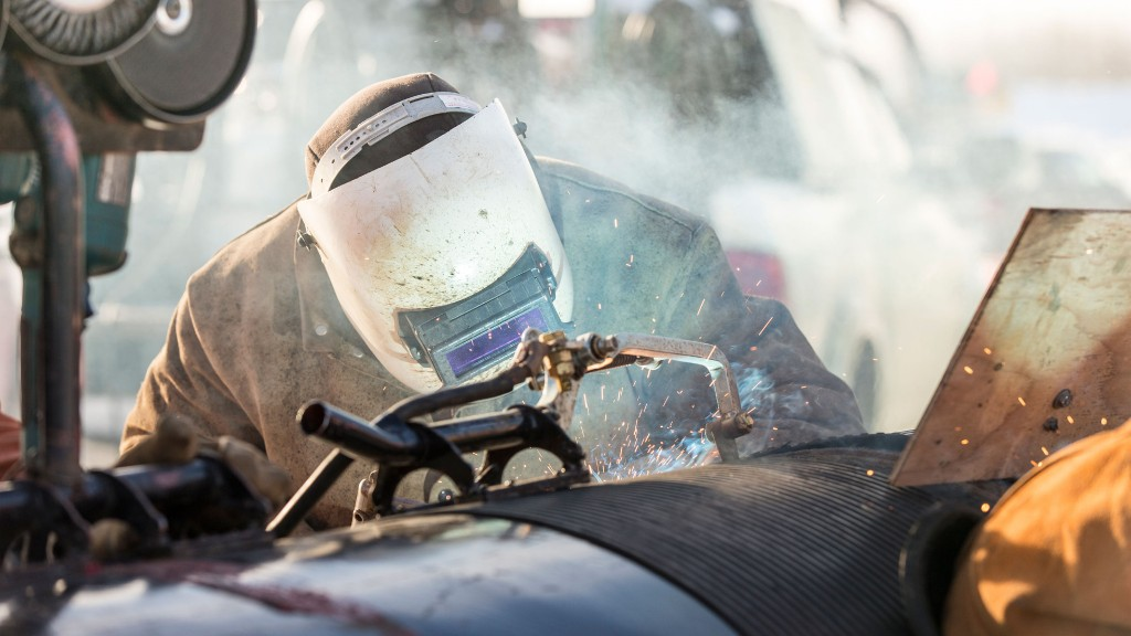 A welder works on an NGTL expansion project in Alberta. TC Energy photo.