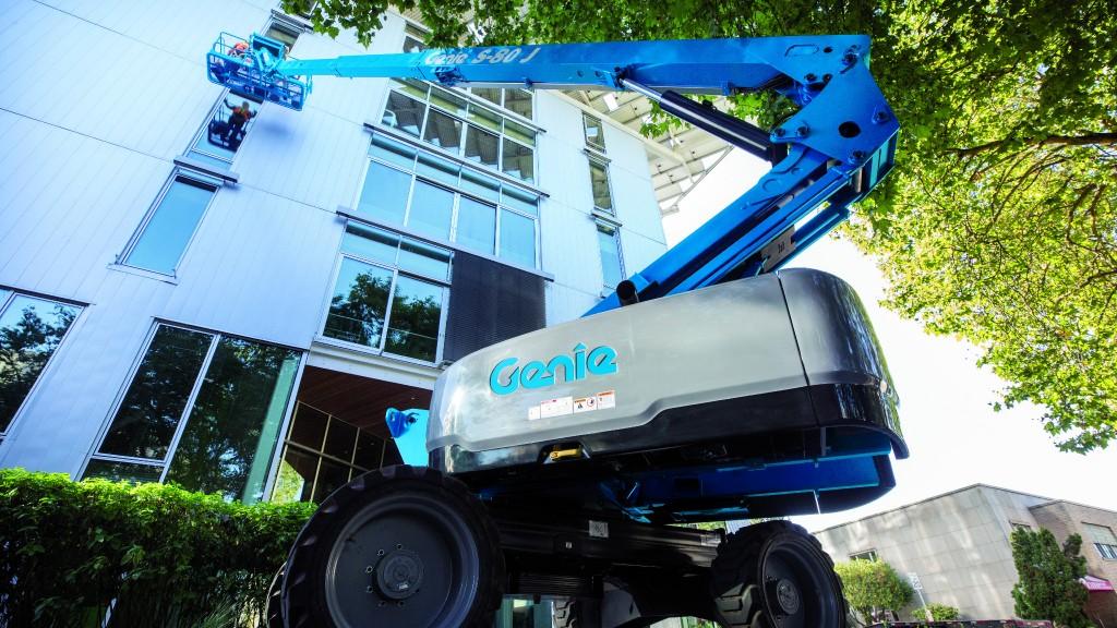 A Genie S 80 J telescopic boom lift on the job site