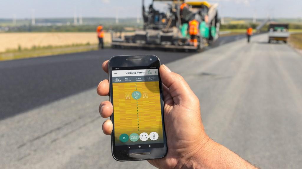 A worker uses the Jobsite Temp app