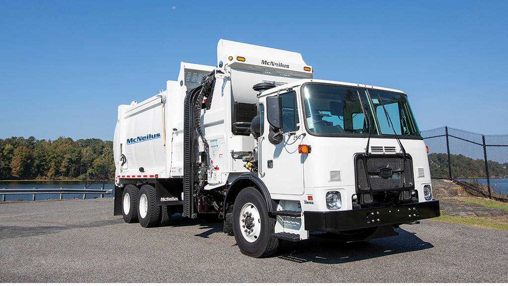 McNeilus side loader collection truck parked on a road