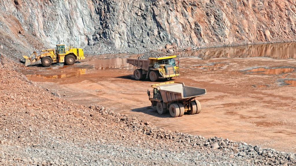 Haul trucks and wheel loader in a quarry