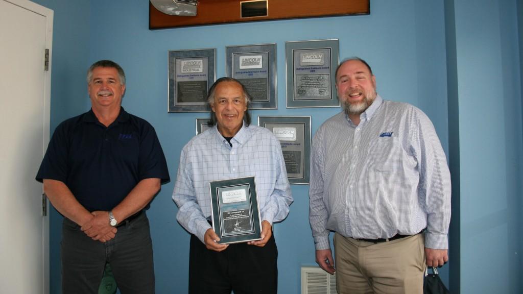 Company executives recieve an industry award