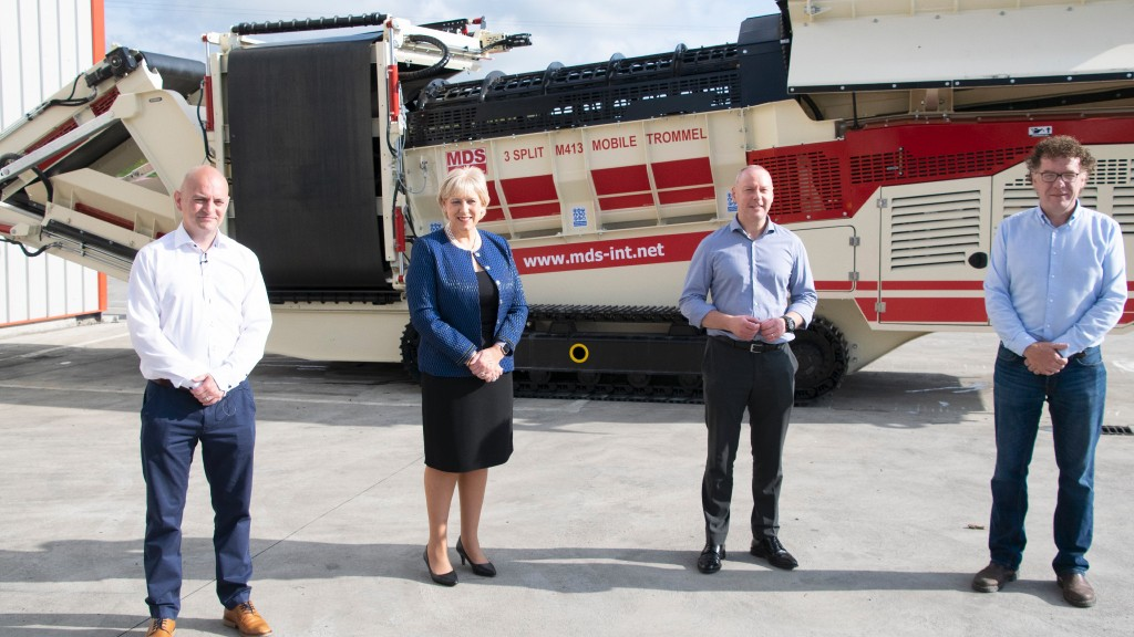 Managers of Terex and founders of MDS International pose for a photo