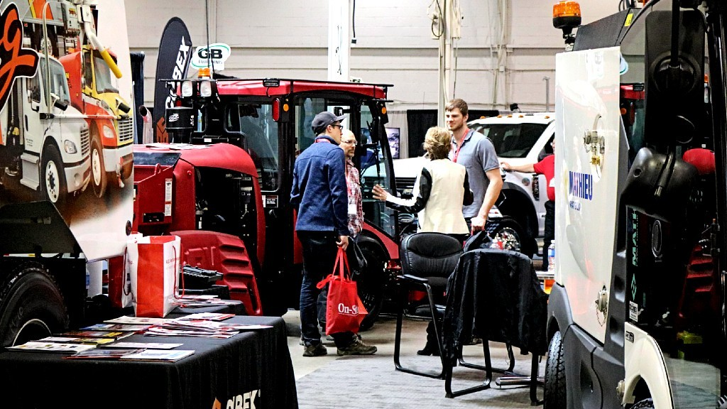 People looking at heavy equipment at a trade show