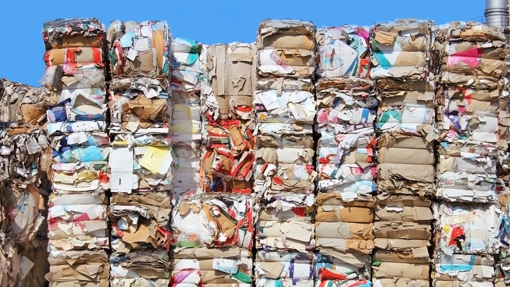 Bales of cardboard recycling stacked