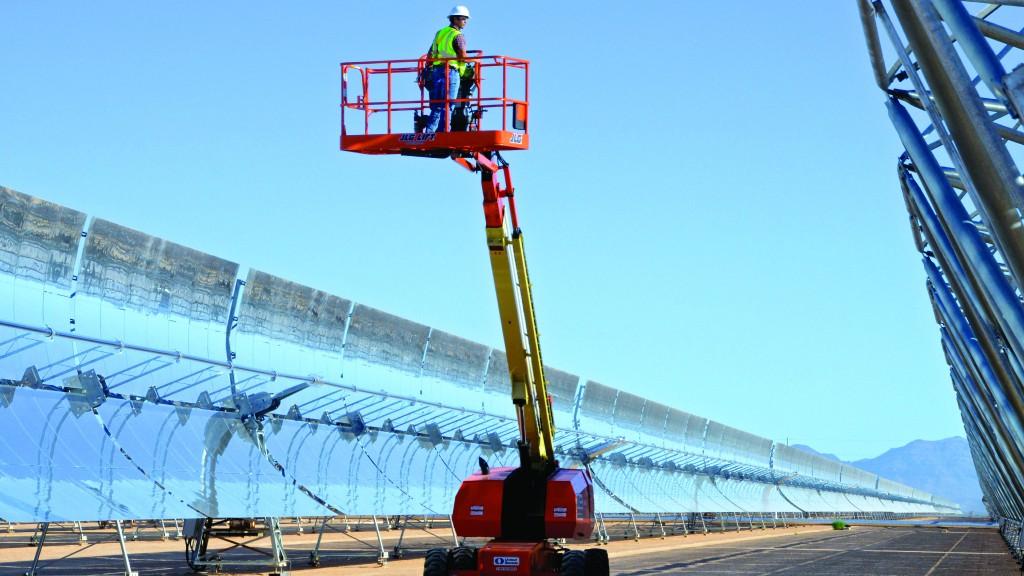 A JLG boom lift on the job site